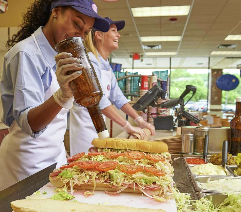 Workers make subs at a Jersey Mike's shop in Holmdel, N.J. A Jersey Mike's shop is scheduled to open in the summer of 2019 at 1259 E. Putnam Ave., in Greenwich, Conn. Photo: Contributed Photo