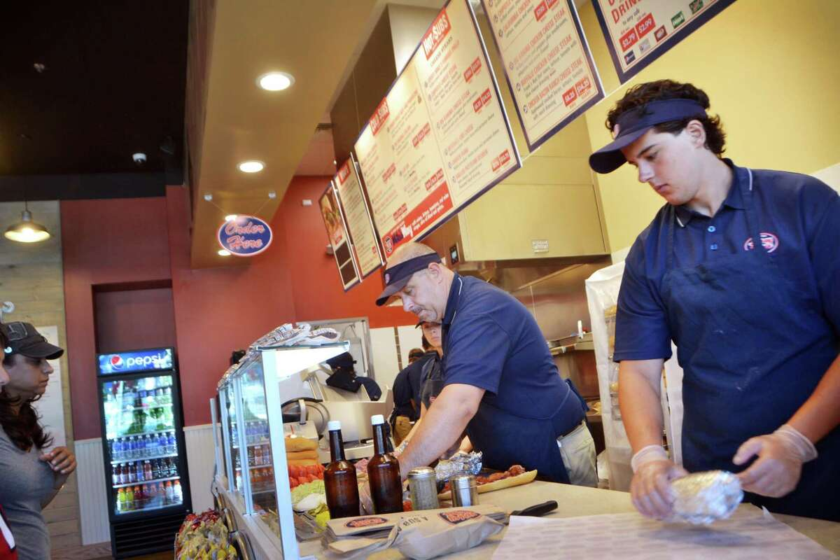 New Store Owner and Trainer, Anthony Cappetto, and Arthur Delibero, of Ansonia, prepare subs at Jersey Mike's Subs in Derby, Conn. on July 23, 2015.