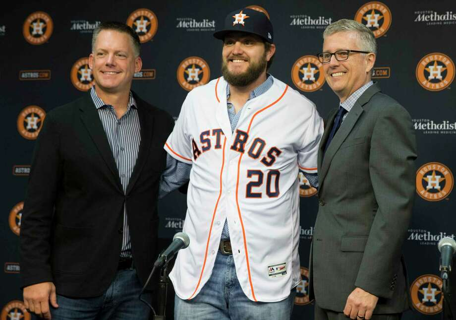 The Houston Astros Manager A.J. Hinch, left, and General Manager Jeff Luhnow introduces left-handed pitcher Wade Miley during a press conference at Minute Maid Park on Friday, Feb. 1, 2019, in Houston. Miley  and the Astros reached a one-year, $4.5 million deal. Photo: Yi-Chin Lee, Staff Photographer / © 2019 Houston Chronicle