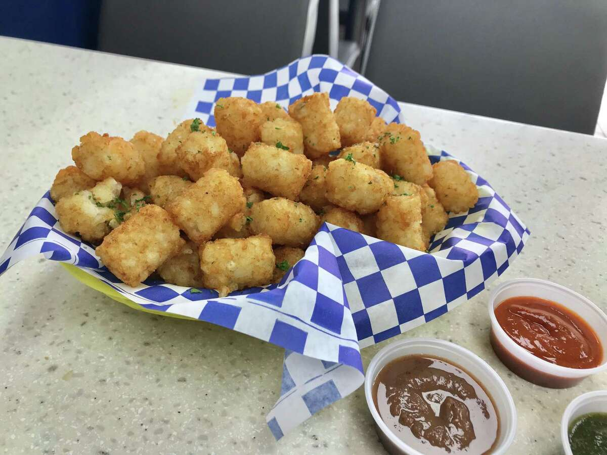 Tater tots with chutneys and house hot sauce at Twisted Turban