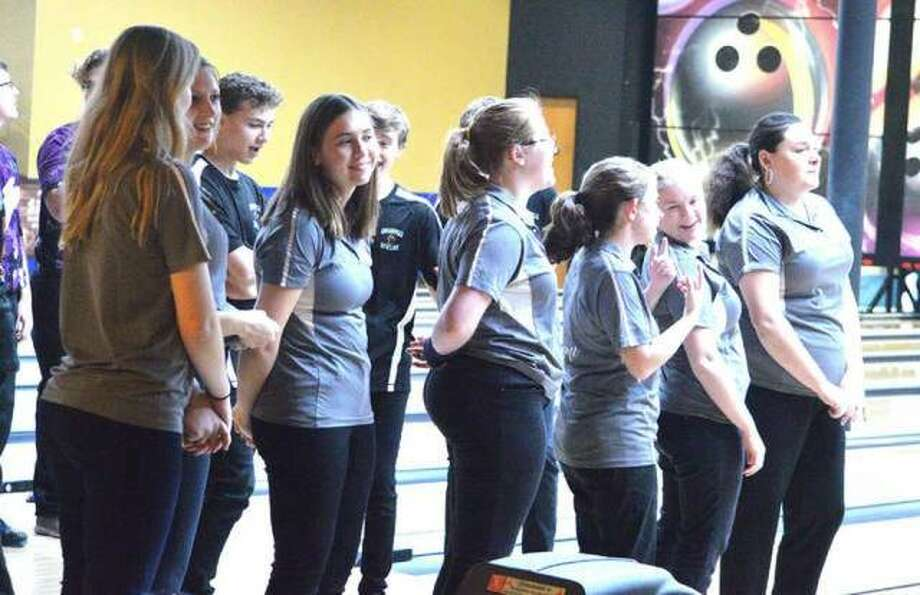 The Edwardsville girls' bowling team lines up for the national anthem prior to a Southwestern Conference dual match against Collinsville on Jan. 8 at Edison's Entertainment Center.