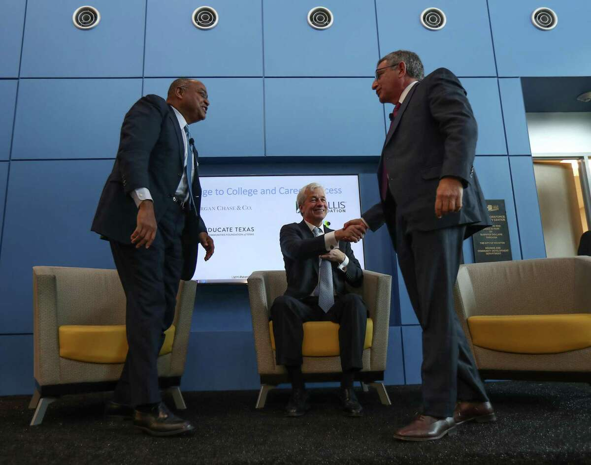 Harris County Commissioner for Precinct One Rodney Ellis, left, Chase Bank CEO Jamie Dimon, center, and Baylor College of Medicine Dr. Paul Klotman talk during a Jan. 31, 2019, event at SER Jobs where Chase is donating $1.3 million to help disconnected youths.