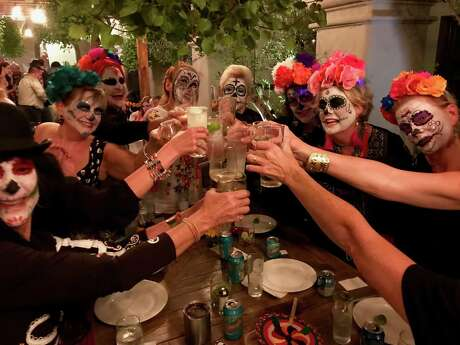 A group of Austin Next Tribers raise a toast during a trip to San Miguel de Allende, Mexico, for Day of the Dead.