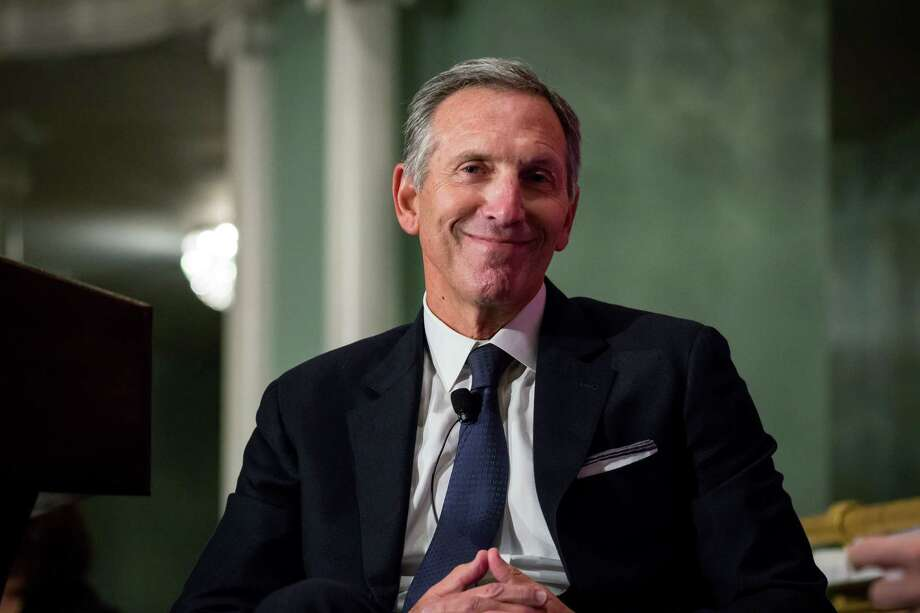 Howard Schultz, then chairman of Starbucks, smiles during a conference at the Economic Club of New York in New York in May 2017.  Keep clicking for photos of Howard Schultz through the years... Photo: Bloomberg Photo By Michael Nagle / Bloomberg