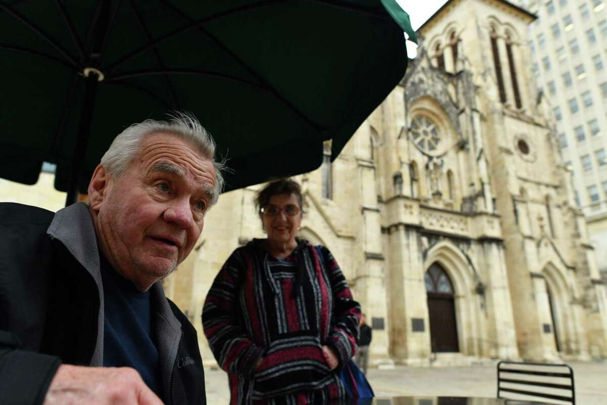 """Jim Rudie and his wife, Sue, sit outside of San Fernando Cathedral on Thursday, Jan. 31, 2019, hours after Archbishop Gustavo Garcia-Siller released a list of priests """"credibly"""" accused of sexual abuse. The couple from Minnesota said that they are concerned for the """"good"""" priests who are no longer trusted."""