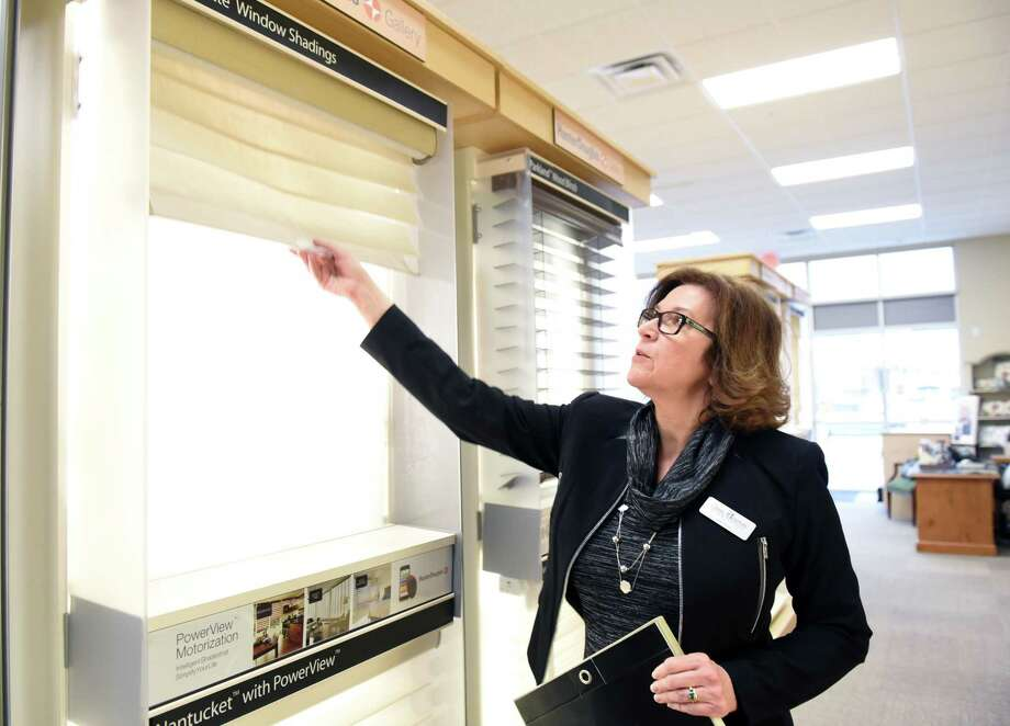 Classic Interiors designer/owner Lynn Ricci talks about silhouette shades on Wednesday, Jan. 16, 2019 at her store in Clifton Park, N.Y. (Phoebe Sheehan/Times Union) Photo: Phoebe Sheehan / 20045947A