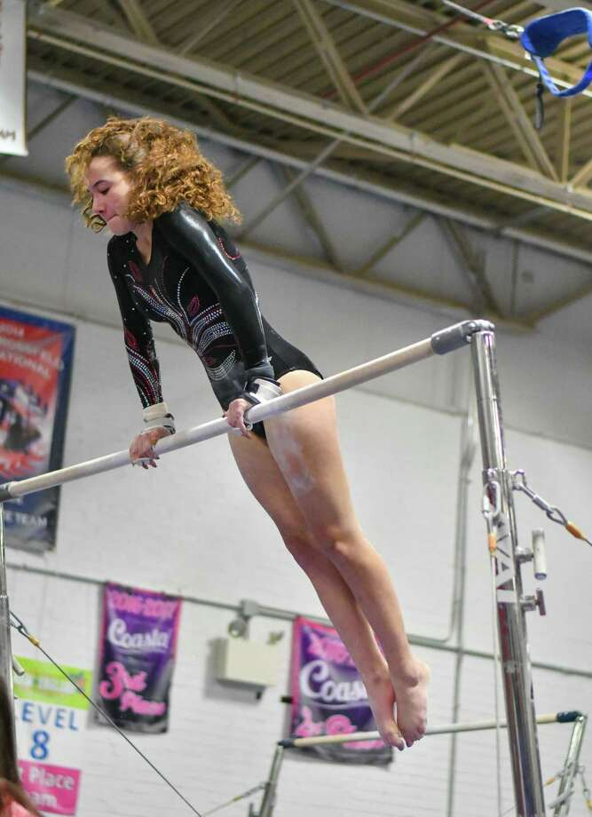 Marissa Coletti of the Fairfield Warde Mustangs competes on the uneven bars during a meet against the Fairfield Ludlowe Falcons and Staples Wreckers on Thursday January 31, 2019 at the Gymnastics and Cheer Academy in Fairfield, Connecticut. Photo: Gregory Vasil / For Hearst Connecticut Media / Connecticut Post Freelance