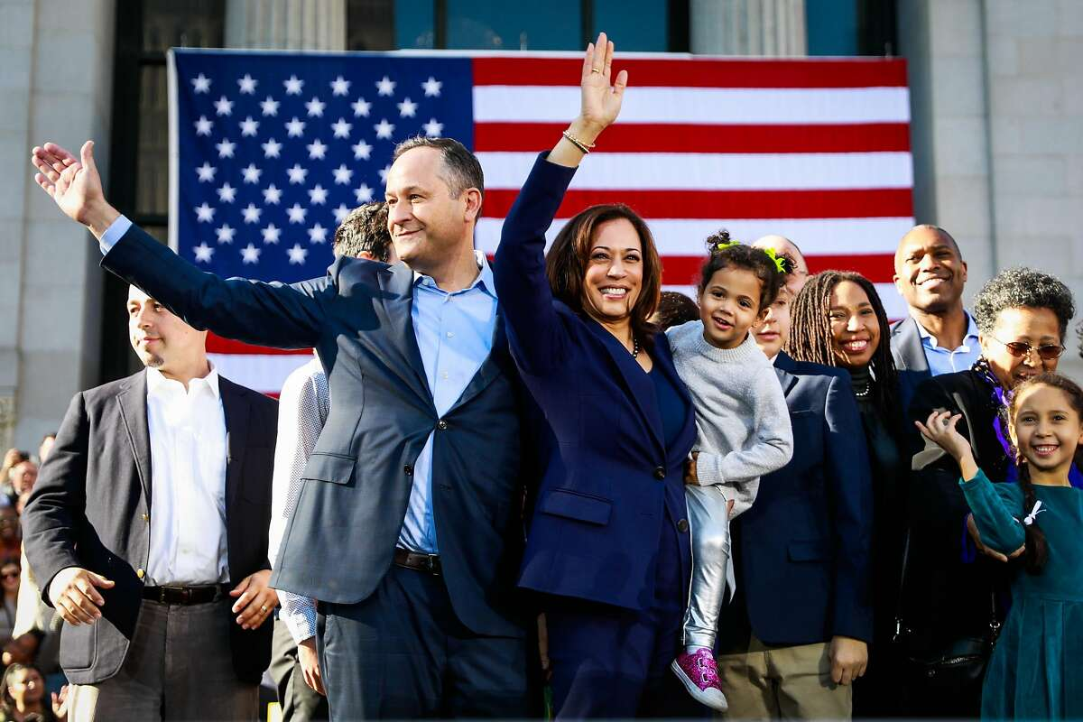 Senator Kamala Harris holds her niece Amara as she and her husband Douglas Emhoff wave to the crowd after making her first presidential campaign rally in her hometown of Oakland, California, on Sunday, Jan. 27, 2019.