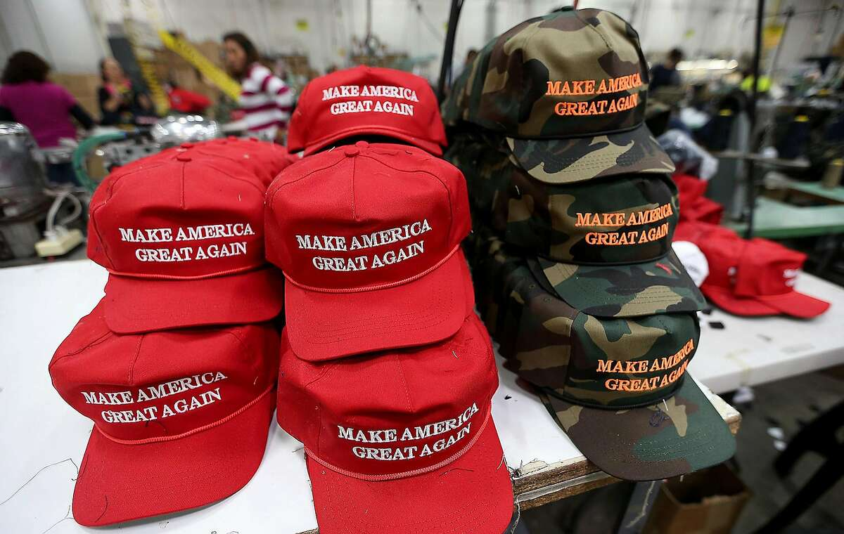 """FILE PHOTO: Workers stitch together hats on the factory floor of Cali Fame and Cali Headwear in Carson, Calif. The hat and apparel maker is best known for producing Donald Trump's """"Make America Great Again"""" baseball caps."""