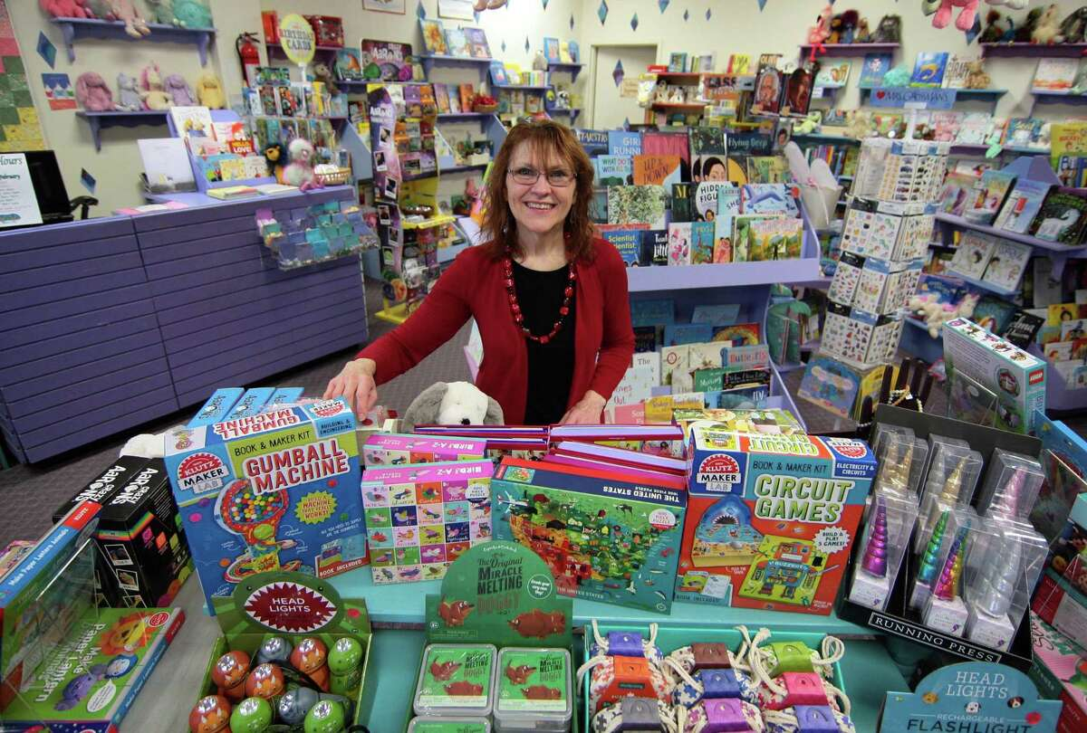 Linda Devlin, who owns Linda's Story Time Bookstore, poses at the store in Monroe, Conn., on Tuesday Jan. 29, 2019. Devlin is retiring this summer, and recently announced that store will soon have a new name and a new owner.