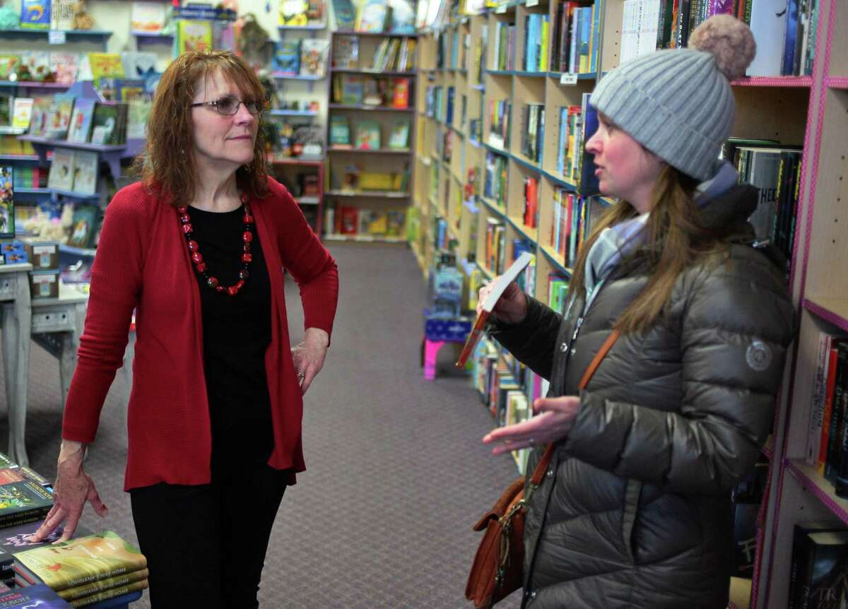 Customer Kelly Pietro, right, chats with Linda Devlin, owner of Linda's Story Time Bookstore in Monroe, Conn., on Tuesday Jan. 29, 2018. Devlin is retiring this summer, meaning this store will join Stepney Hardware as another town institution that is on its way out. She is actively looking for someone to buy the business.