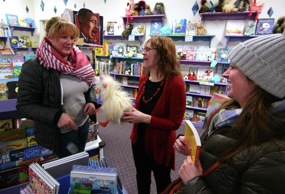 Customers Barbara Fahr, left, and Kelly Pietro, right, chat with Linda Devlin, owner of Linda's Story Time Bookstore in Monroe, Conn., on Tuesday Jan. 29, 2018. Devlin is retiring this summer, meaning this store will join Stepney Hardware as another town institution that is on its way out. She is actively looking for someone to buy the business.