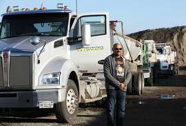 Ravinder Singh poses for a portrait with his truck in Newark, Calif., on Thursday, January 31, 2019. A possible new California law would make more independent contractors become employees. Singh has been an independent truck owner-operator since the late 1990s, and prefers to stay an independent contractor, not an employee.