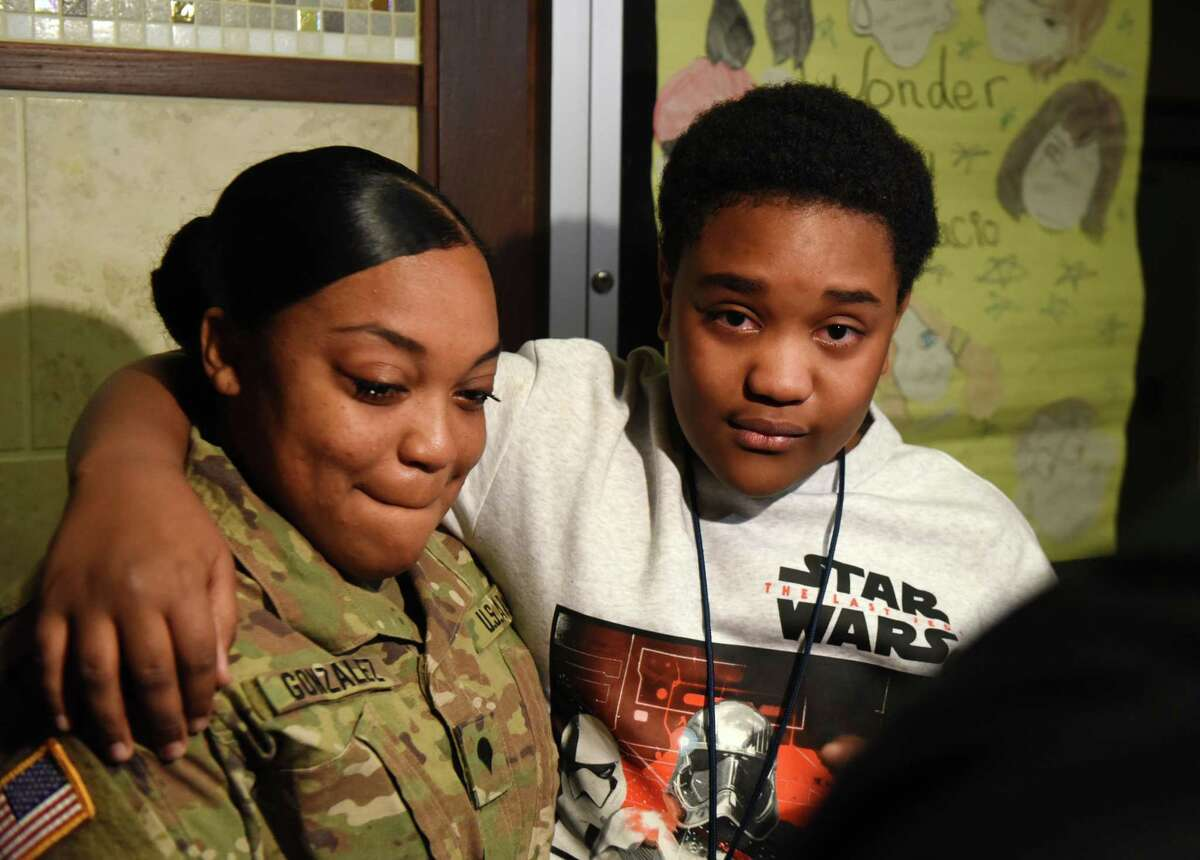 Christopher Sang is reunited with his mother, Erica Gonzalez, at Hackett Middle School on Friday, Feb. 1, 2019, in Albany. Gonzalez and her sister, Jessica, have been away on military deployment since March of last year.
