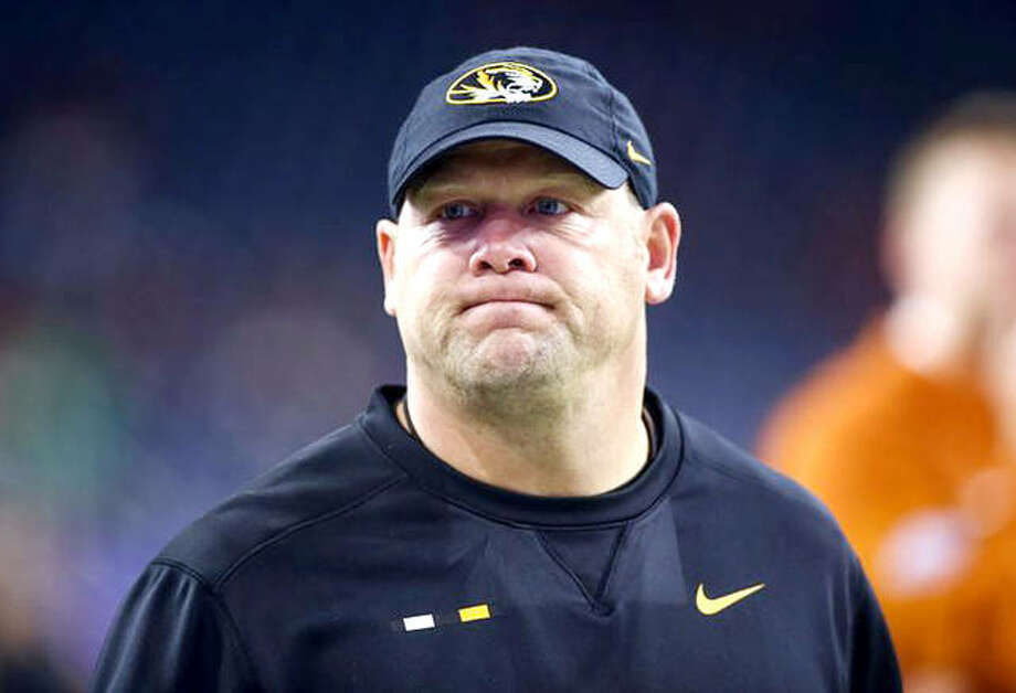 Missouri football coach Barry Odom's Tigers were 8-5 in 2018 and made a bowl appearance. There will be no bowl next season, however, after the NCAA hit the school with sanctions Thursday for academic misconduct involving a tutor. The Tigers were hit with a postseason ban for the upcoming season, were told to vacate wins, docked scholarships and hit with potentially long-reaching recruiting restrictions. The softball and baseball programs, which also had athletes involved in the misconduct, were saddled with the same penalties and the entire athletic department landed on probation. Photo: File Photo