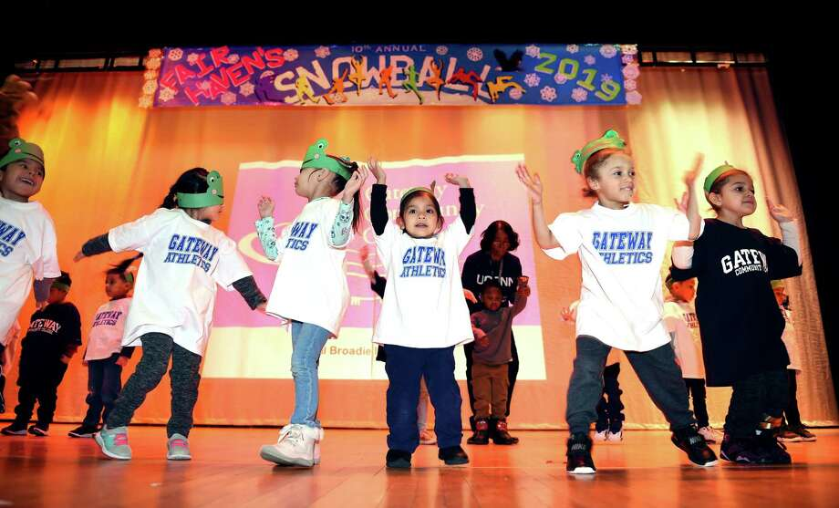 Pre-K students perform a dance routine wearing Gateway Community College shirts during the annual Snowball at Fair Haven School in New Haven. Photo: Arnold Gold / Hearst Connecticut Media / New Haven Register