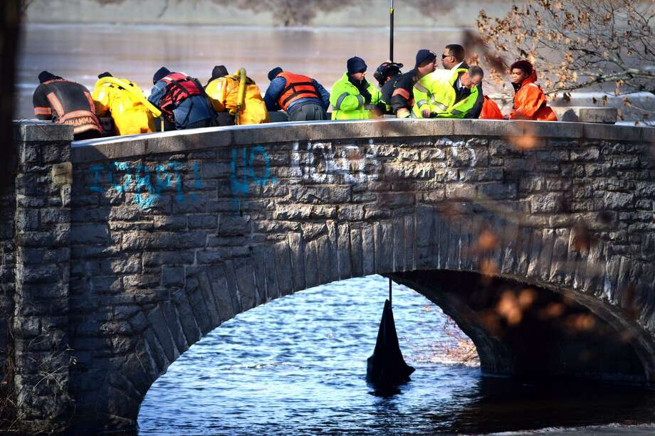 First responders retrieve an item of clothing from the water of Bunnell's Pond, at Beardsley Park in Bridgeport, Conn. Conn. Jan. 31, 2019. City official confirmed that a body was found floating in the pond Thursday morning. Photo: Ned Gerard / Hearst Connecticut Media / Connecticut Post