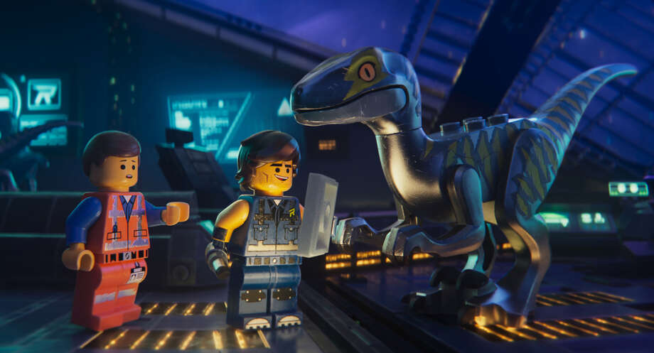 "This image released by Warner Bros. Pictures shows the characters Emmet, left, and Rex Dangervest, center, both voiced by Chris Pratt, in a scene from ""The Lego Movie 2: The Second Part."" (Warner Bros. Pictures via AP) Photo: Eric Charbonneau/AP"