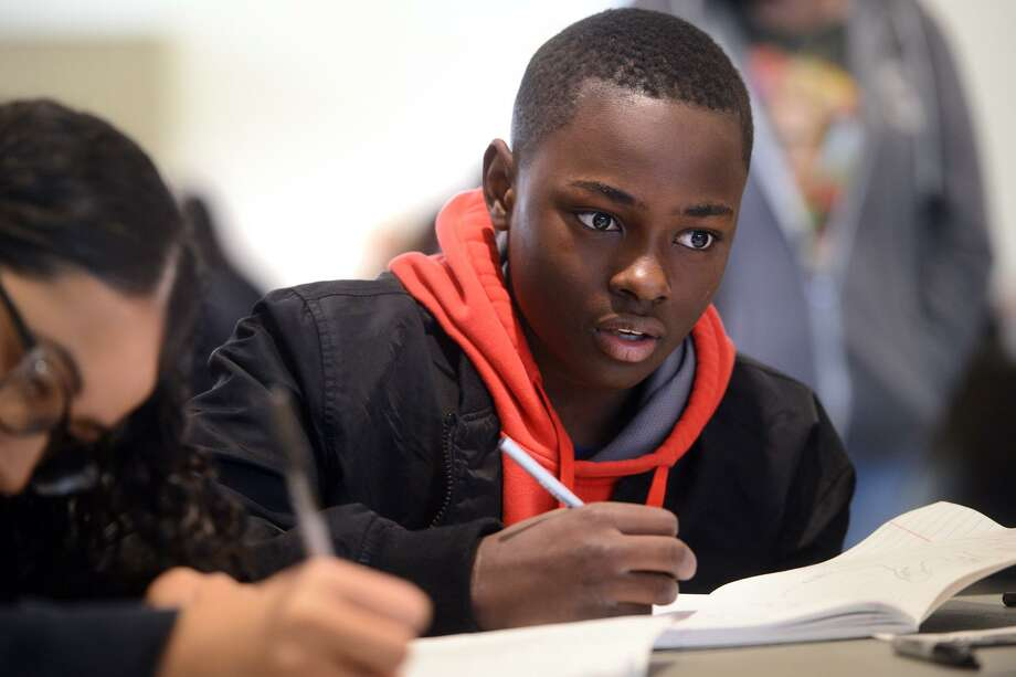 Anthony Dozier, a 7th-grader from Cesar Batalla School, in Bridgeport, works on an essay during a writing workshop at Fairfield University, in Fairfield, Conn. Feb. 1, 2019. The workshop was part of the university's Dr. Martin Luther King, Jr. celebration, and included students from several Bridgeport schools, who discussed and wrote about King's legacy. Photo: Ned Gerard / Hearst Connecticut Media / Connecticut Post