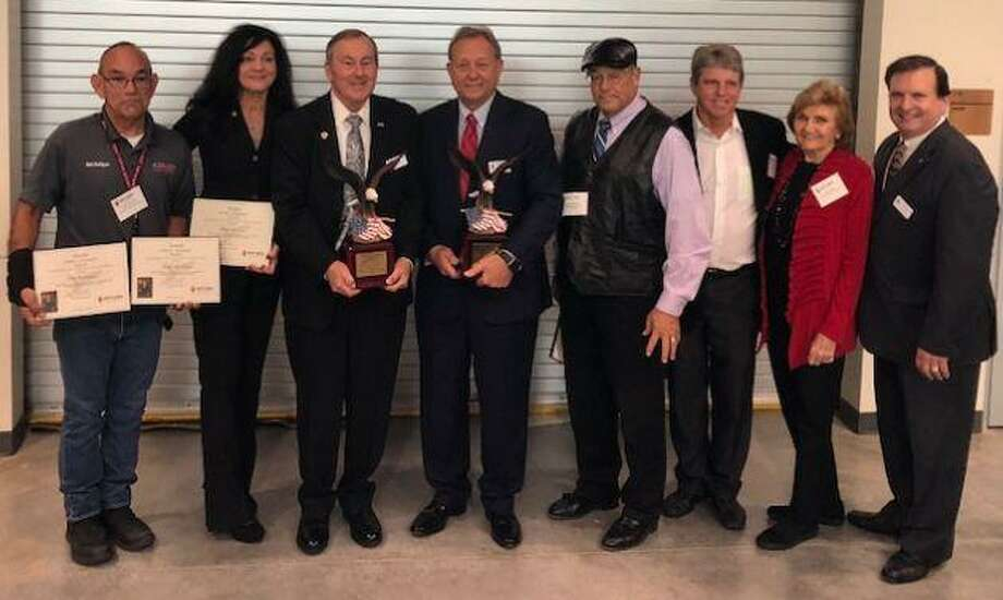 """Nominees, from left, for the Stan C. Stanley """"Eagle"""" Leadership and Economic Development Awards are Mark Rodriguez, Rhedonda Cox, Chuck Brawner, Dick Phillips, Thom Polvogt, Monty Ballard, and Patsy Stanley, Stan Stanley's widow; and Paul Kurt, chairman of the nominating committee. Photo: Katy Area EDC / Katy Area EDC"""