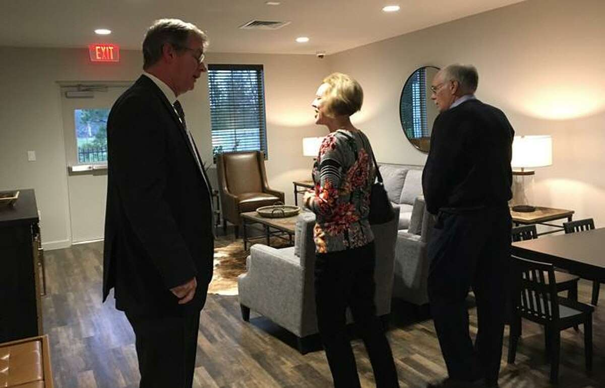 After Monty Ballard cut the ribbon to open the addition to The Ballard House, visitors were able to tour the new facility which includes 16 guest rooms, a living room, kitchen and laundry room. Above, Cinco Charities Board of Directors Chairman Dave Brown, left, talks with visitors to the grand opening celebration in the living room of the addition.