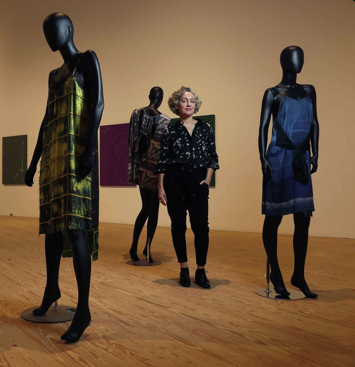 """Artist Cheryl Donegan within her solo show """"GRLZ + VEILS"""" at the Contemporary Arts Museum Houston, Friday, Jan. 18, 2019, in Houston. The show features a highly curated selection of Donegan's work including paintings, videos, unstretched hanging printed fabrics, and a new collection of clothing."""