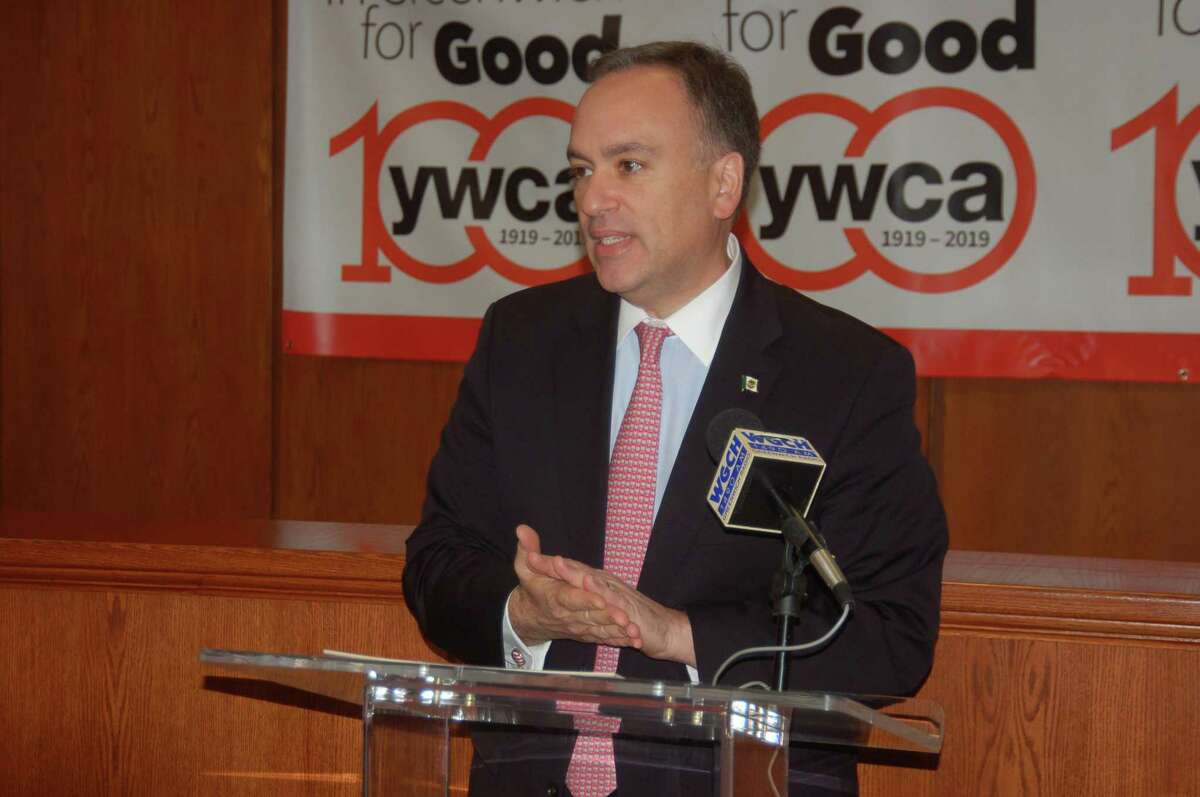 First Selectman Peter Tesei offers his support for the YWCA, YNET and Teen Dating Violence Awareness and Prevention Month by reading a proclamation from the town in a Town Hall ceremony on Friday afternoon.