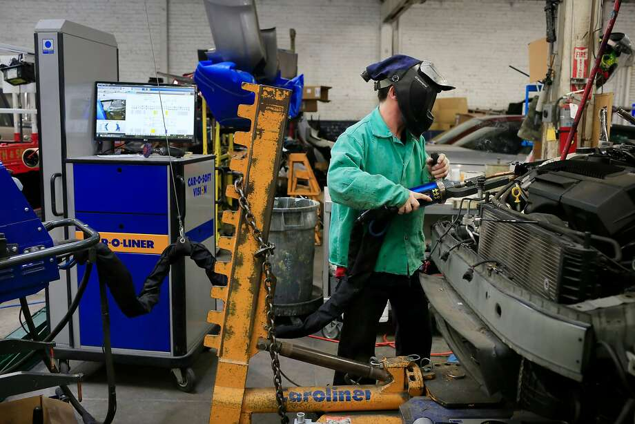 Tom Lehman, senior technician, uses a resistance spot welder while installing an upper frame rail to a car while working at George V. Arth & Son auto body repair shop on Monday, November 20, 2017 in Oakland, Calif. Photo: Lea Suzuki / The Chronicle