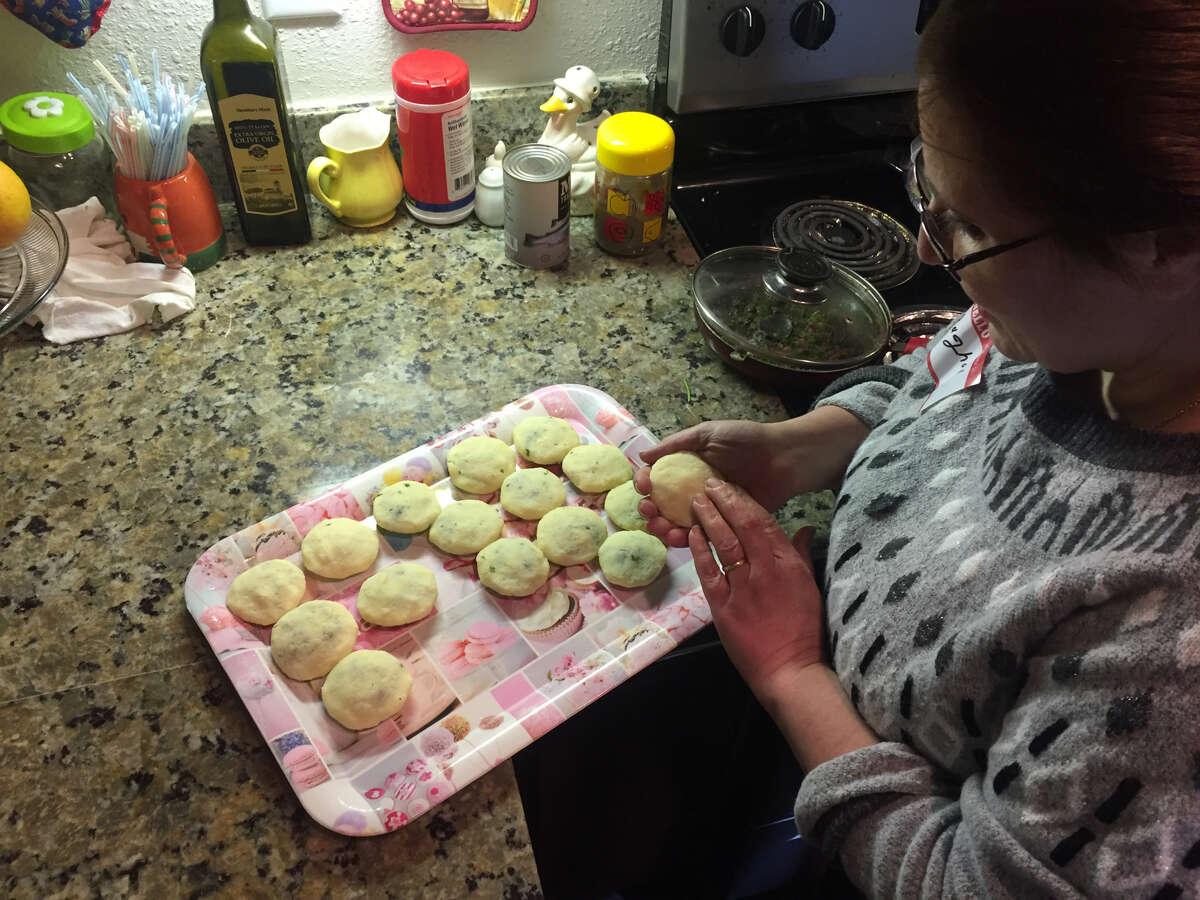 Raghad Al Samaan prepares kibbeh in her Houston home.