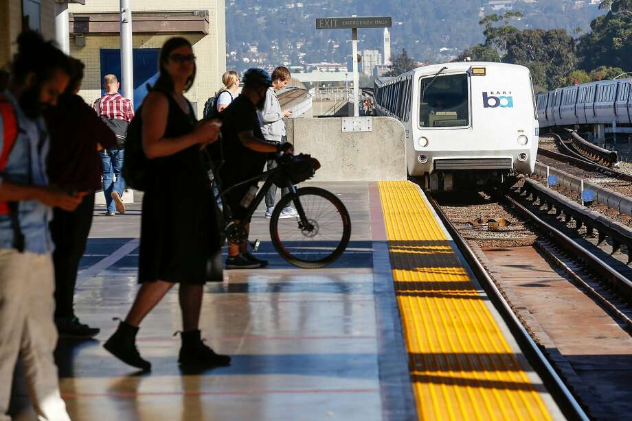 Passengers wait for a train at MacArthur BART Station on Friday, November 2, 2018 in Oakland, Calif. Photo: Amy Osborne / Special To The Chronicle 2018