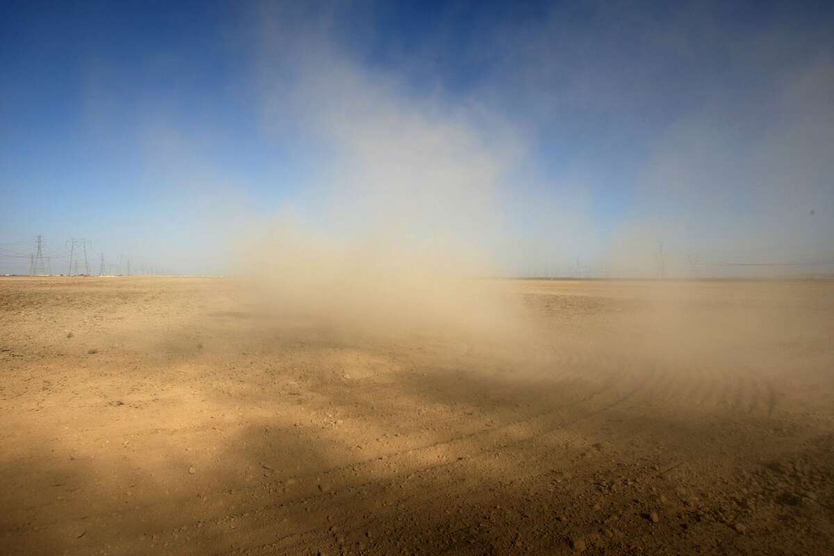 Dust billows as a farmer plows a dry field in Kern County, California.Documented cases of Valley Fever rose 11 percent in 2018 - a preliminary total of 7,886 cases compared to 7,090 cases for the same period in 2017, according to California Department of Public Health.