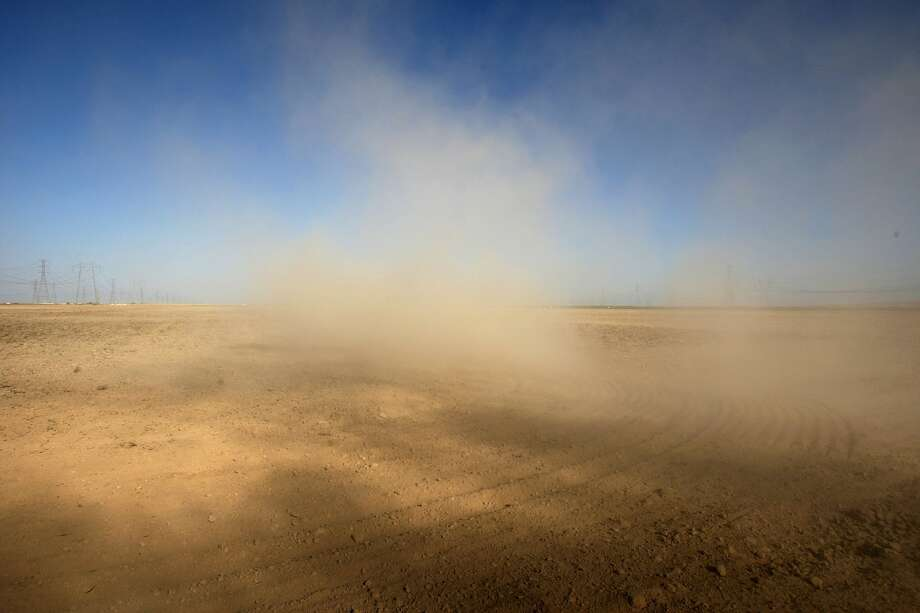 Dust billows as a farmer plows a dry field in Kern County, California. Documented cases of Valley Fever rose 11 percent in 2018 — a preliminary total of 7,886 cases compared to 7,090 cases for the same period in 2017, according to California Department of Public Health. Photo: David McNew/Getty Images, Getty