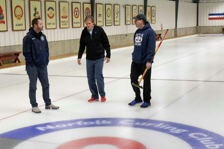 Tyler George, left, a member of Team USA who won the Olympic Gold Medal in curling at last year's Olympics, and state Sen. Kevin Witkos, center, were guests of the Norfolk Curling Club on Thursday, Jan. 31. Part of the visit were curling lessons for Witkos. Photo: Contributed Photo / / All Rights Reserved