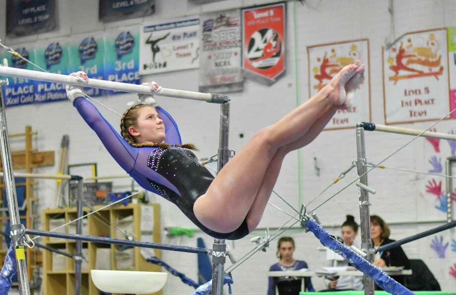 Fairfield Ludlowe's Lyla Vogel competes on the uneven bars during a meet against Fairfield Warde and Staples on Thursday. Photo: Gregory Vasil / For Hearst Connecticut Media / Connecticut Post Freelance