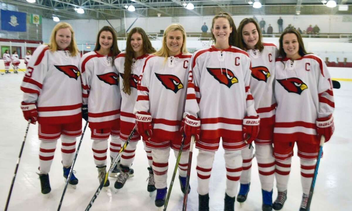 From left to right, Lucy Fulton, Nicole Huber, Katie Walko, Jennifer Kelly, Grace Fahey, Hayley Duffy and Grace Finneran were the seniors on the Greenwich High School hockey team honored on Senior Night Thursday at Dorothy Hamill Skating Rink.