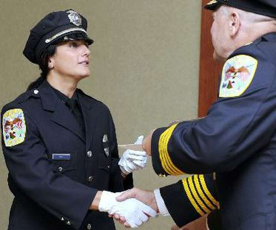 Police Officer Regina Guss receives a citation at the Danbury Police Department's 28th Annual Awards Ceremony in 2012. Photo: Carol Kaliff