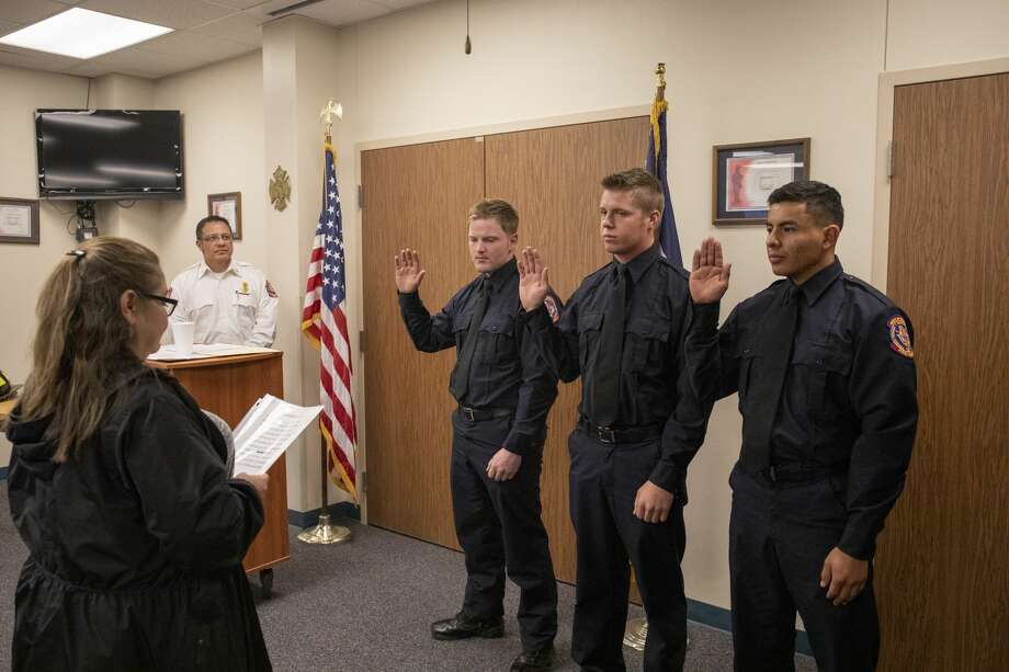 Odessa Fire Rescue's new firefighters Dillon Bomar, Jared Cowen and Eduardo Hurtado are sworn in during a badge pinning ceremony Thursday. Photo: Jacy Lewis/191 News