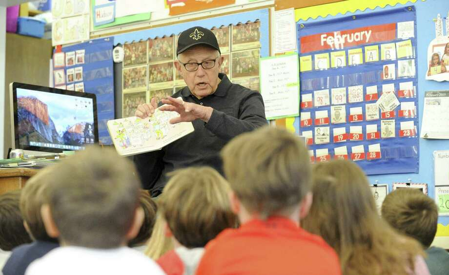Former Greenwich Superintendent of Schools Ernest Fleishman reads Clifford's Valentine's Day to Louise Williamson's Kindergarten class during Old Greenwich School's 2nd annual World Read Aloud Day (WRAD) event on Friday, Feb. 1, 2019 in Greenwich, Connecticut. Over 75 readers joined Fleishman, reading various books to the students. The event, in its tenth year, was founded by Lit World. Photo: Matthew Brown / Hearst Connecticut Media / Stamford Advocate