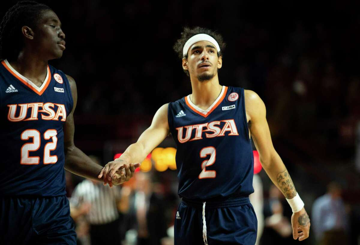 Keaton Wallace, left, scored 22 points to become the second UTSA player to exceed 2,000 career points, and Jhivaan Jackson scored 32 to become the first Roadrunner to exceed 2,500 career points in the Roadrunners' rout of UAB on Saturday at the Convocation Center.