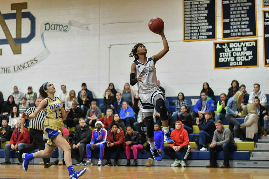 Ciara Brown of the Notre Dame-Fairfield glides to the basket for a lay-up against Newtown in a Jan. 18 game in Fairfield. Photo: Gregory Vasil / For Hearst Connecticut Media / Connecticut Post Freelance