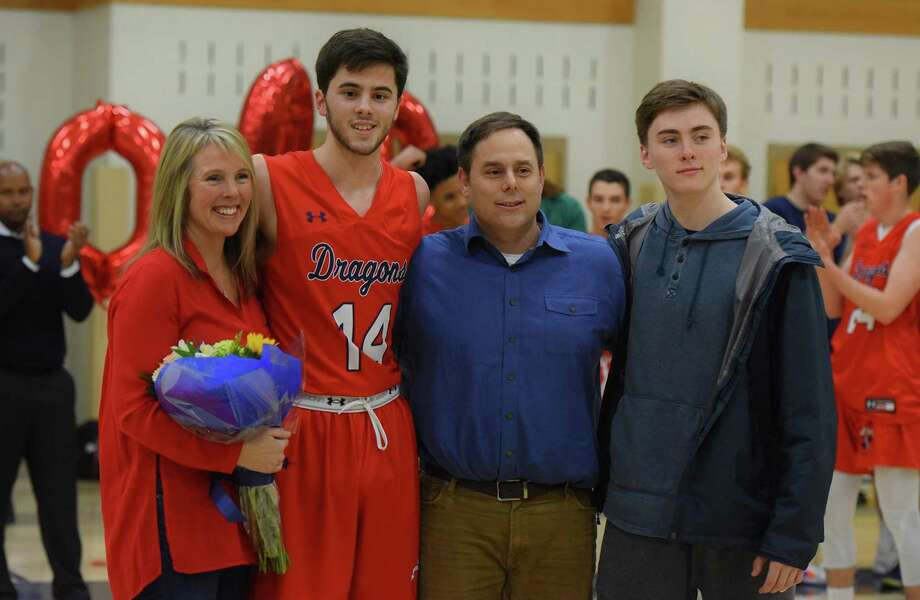 GFA boys basketball player Greg Lawrence, second from left, a resident of Fairfield, was honored for scoring the 1,000th point of his career during Friday's game against Redemption Christian Academy. Photo: Greens Farms Academy Athletics