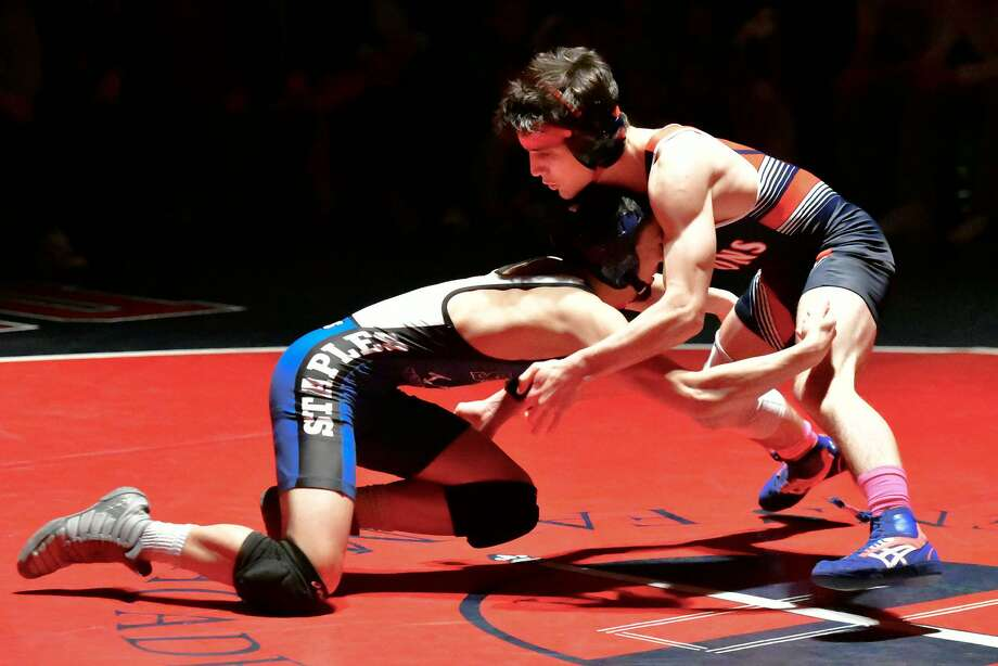 GFA wrestler Griffin Seyfried, right, competes against Staples during Friday's Town Crown wrestling showdown in Westport. Photo: Contributed Photo / Greenwich Time Contributed