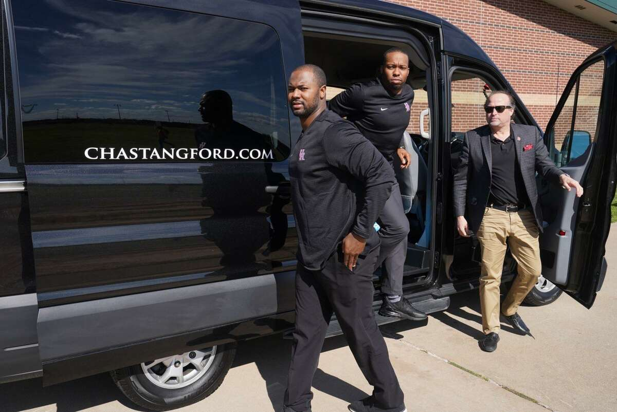 UH coach Dana Holgorsen, right, and staff are visiting area high schools en masse before the Feb. 6 signing day.