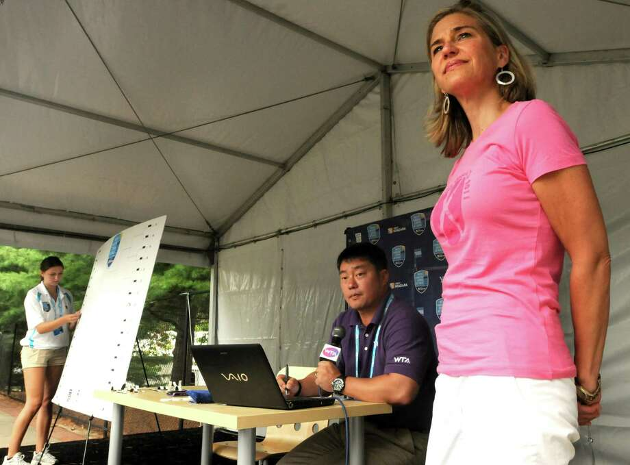 Anne Worcester, the New Haven Open Tournament Director, right, with Tony Cho, Womens Tennis Association supervisor, center and Alex Petrini, New Haven Open marketing coordinator, far left, cooridnate the Main Draw announcements Friday 8/19/11 at the Connecticut Tennis Center in New Haven. Photo by Peter Hvizdak / New Haven Register August 19, 2011 ph2344 Connecticut