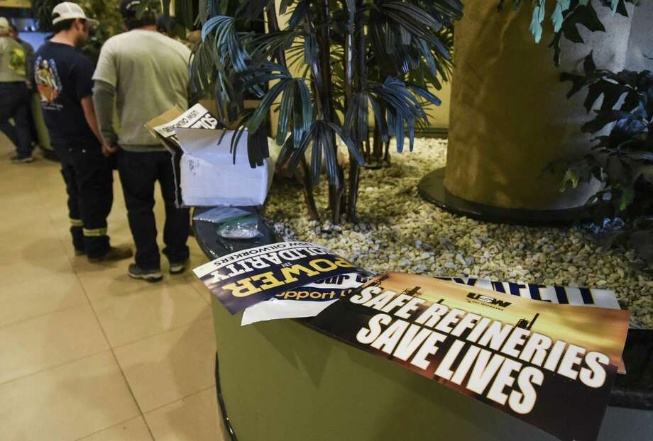 """Signs that read """"Safe Refineries Save Lives"""" and """"Power in Solidarity"""" lay out in a Port Arthur hotel where members of the United Steelworkers Union Local 13-423 gathered as national leadership continued to negotiate out a contract with Valero set to expire in a little over a day. Photo taken on Wednesday, 01/30/19. Ryan Welch/The Enterprise Photo: Ryan Welch / The Enterprise / ©Ryan Welch"""