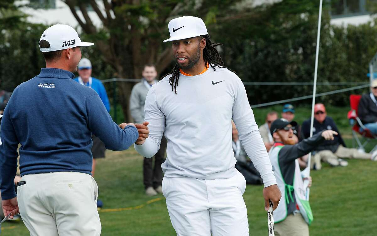 Chez Reavie, (left) gives a fist bump to amateur Larry Fitzgerald after his birdie on the 13th hole, nduring the final round of the AT&T Pebble Beach Pro-Am on the Pebble Beach Golf Links in Pebble Beach, Calif., seen on Sunday Feb. 11, 2018. FItzgerald was the amateur champion of the tournament.