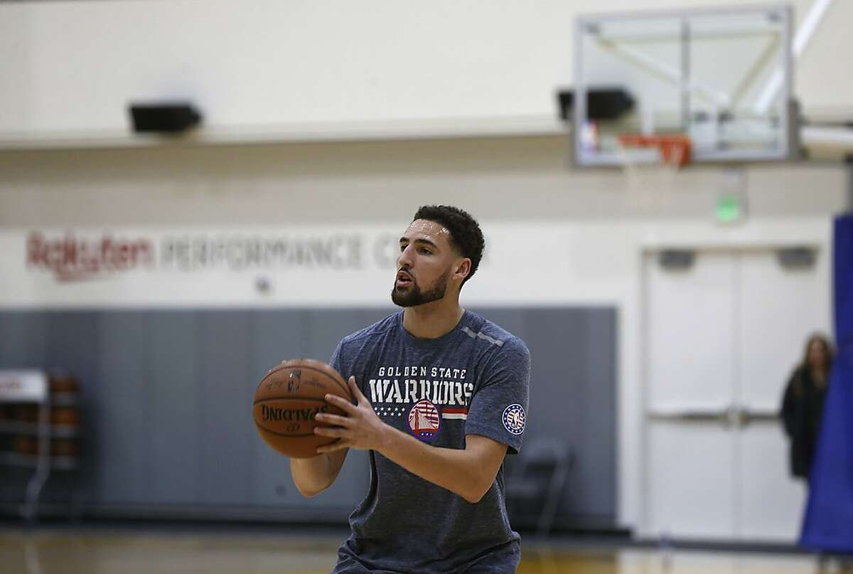 Klay Thompson practices at the Golden State Warriors headquarters while music arranged by special team assistant Khalid Robinson is played through a sound system in Oakland, Calif. on Thursday, Jan. 31, 2019.