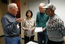 Hal Helfand (left) answers questions from tax preparers, who will be volunteering their services for the AARP Foundation Tax-Aide program, during a two-day training session in Oakland, Calif. on Wednesday, Jan. 23, 2019.