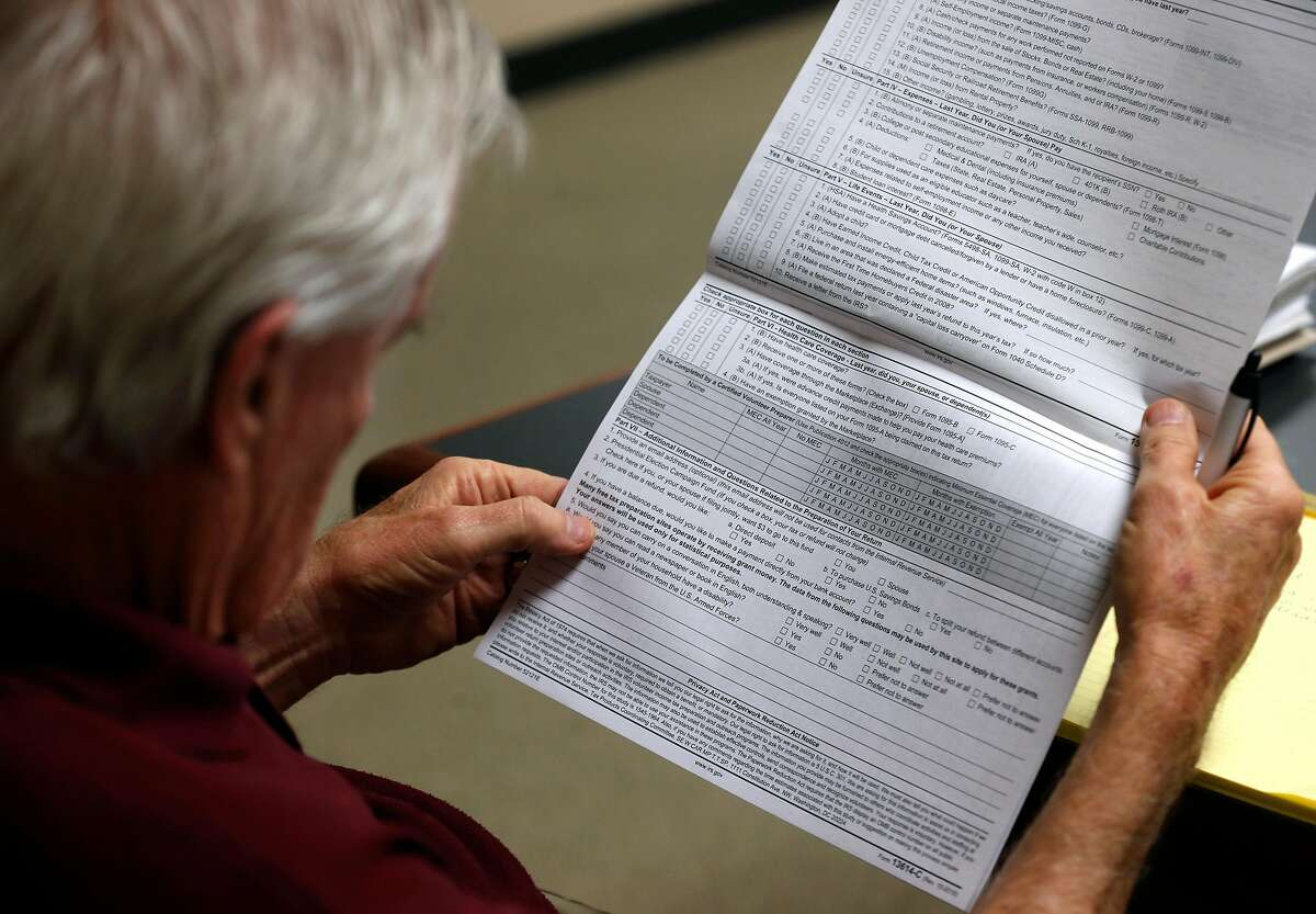 John Mahoney reviews a revised questionnaire during a two-day seminar in Oakland, Calif. on Wednesday, Jan. 23, 2019 to train tax preparers who will be volunteering their services for the AARP Foundation Tax-Aide program.