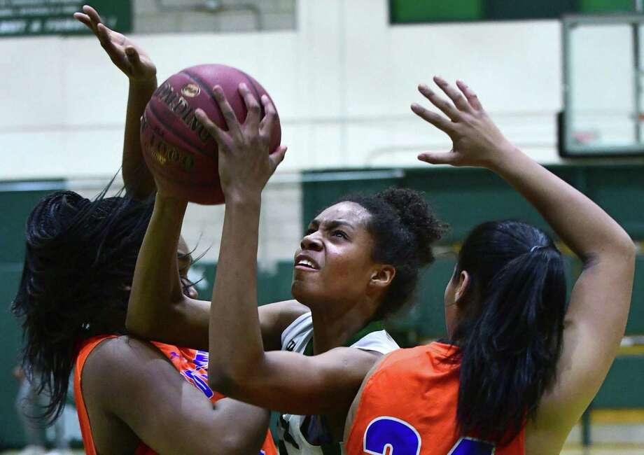 Norwalk's Naeva Rene goes up for the shot in Friday's game against Danbury. Photo: Erik Trautmann / Hearst Connecticut Media / Norwalk Hour